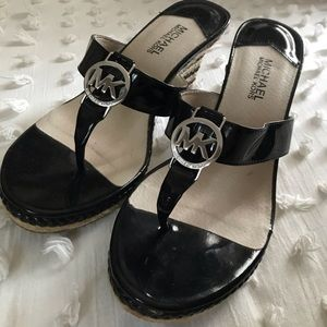Classic black leather wedges by Michael Kors